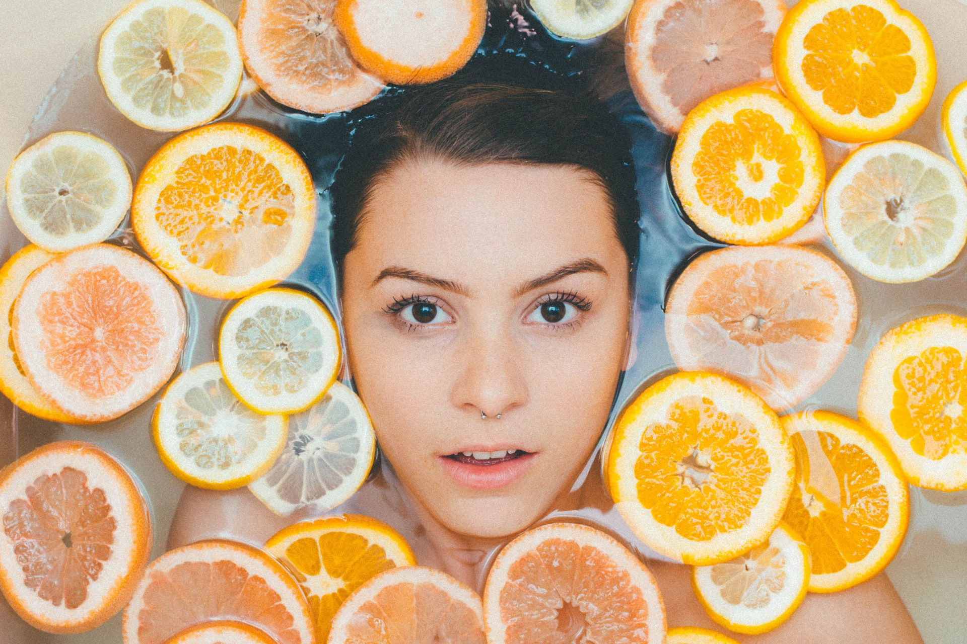 face floating in oranges